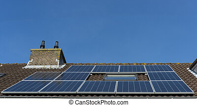 roof with solar panels - twelfe solar panes on roof