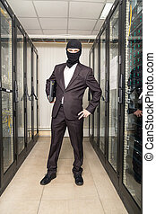 robber in black mask in the server room hack, and steals...