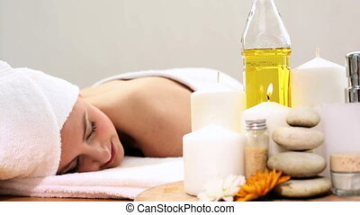 Peaceful woman relaxing on the massage table at a beauty spa
