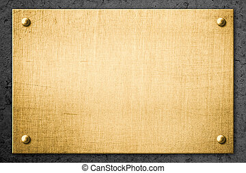 golden metal plate or signboard on wall background