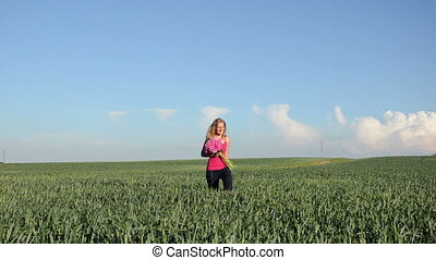 woman corn field day - blonde smiling woman with big pink...