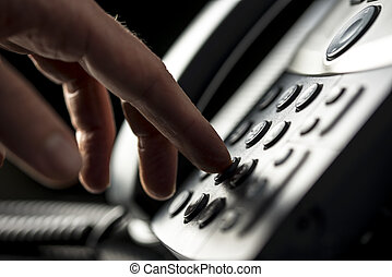 Man making a telepnone call - Closeup view of the hand of a...