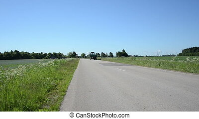 tractor trailer road - Tractor with trailer drive on rural...