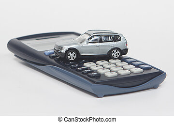 Buy a new car - Calculator and toy car isolated on white...
