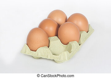 Brown Eggs - Cardboard egg box with five brown eggs isolated...