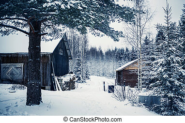 Wooden cottage in winter forest, Central Finland - Wooden...