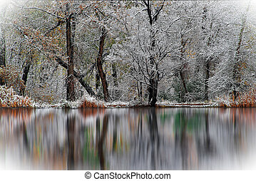 As Fall Reflects Winter - Early snow in autumn reflection in...