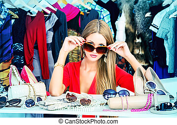 sunglasses - Fashionable girl shopping in a store.