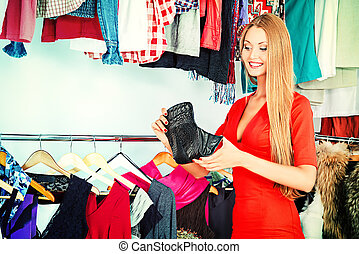 shopping - Fashionable girl shopping in a store.