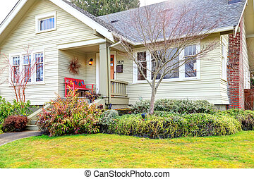 Small front porch with red bench - Siding house with column...
