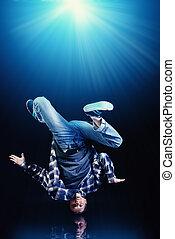 breakdancer - Modern young man dancer over black background.