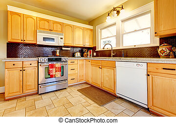 Light tones wood kitchen with brick backsplash design -...