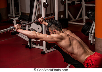 Young Man Doing Exercise For Shoulders - Young Male...