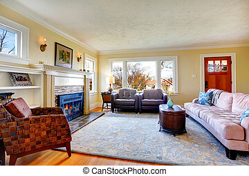 Cozy family room with fireplace and decorated wall with candles