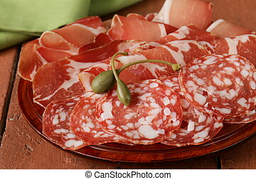 sliced dried sausage meat (ham, prosciutto, salami) served...