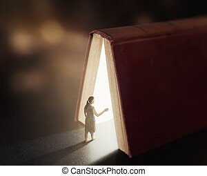 Glowing book with woman. - Woman is lost and wanders into a...