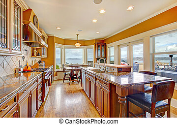 Beautiful bright kitchen room with walkout deck - Yellow and...