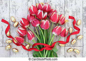 Easter - Gold easter eggs with red tulip flower bouquet and...
