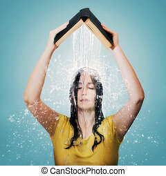 Bible with water falling on woman's head. - Woman holding up...