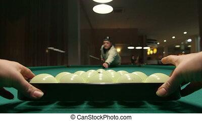 Game of billiards in poolroom - opening break shot