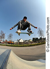 skateboard jump - skateboarder in action at the local skate...