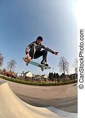 skateboarding - skateboarder in action at the local skate...