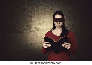 Blindfolded Bible reading - Woman trying to read a Bible...