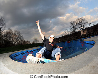 pool skateboarding - skateboarder in action at the local...