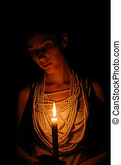 Girl with burning candle in darkness - Girl with burning...