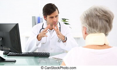 Doctor talking to retired patient