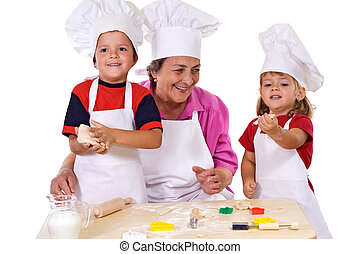 Grandmother with kids making cookies - Grandmother with kids...