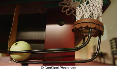 Billiard balls falling in the corner pocket closeup