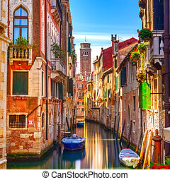 Venice cityscape, narrow water canal, campanile church on...