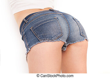 Jeans shorts on perfect buttocks Rear view of woman in jeans...