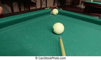 Game of billiards in pool room - shot in corner pocket POV