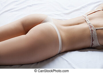 Perfect buttocks Top view image of beautiful young woman...
