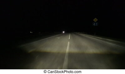 Drive on dividing strip at night POV