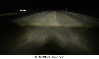 Driving at night highway - Driving car on dividing strip at...