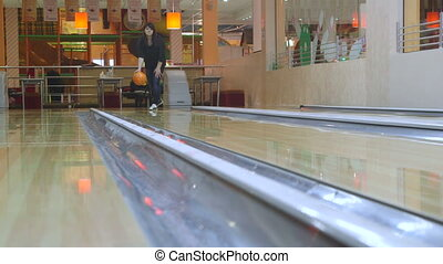 Woman playing bowling in boutique center - Woman bowler...