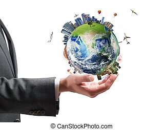 Businessman holds modern World - Concept of business power...