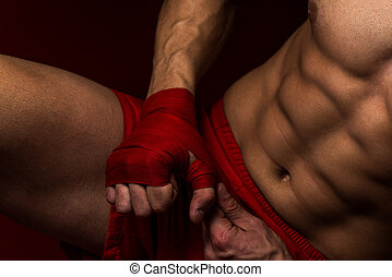 Kick Boxer Putting Straps On His Hands - Muscled Boxer...