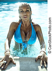 Woman in swimmingpool - Sexy moman in swimmingpool