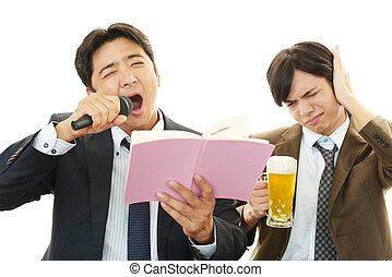Men Singing Karaoke with Beer - Happy Asian men drinking...