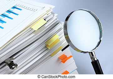 Investigate and analyze. - Magnifying glass and stack of...