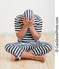 man prisoner - portrait of a repentant man prisoner in...