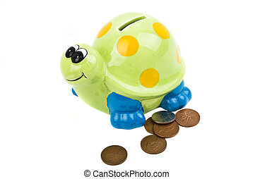 Money box and coins - Money box tortoise with UK coins...