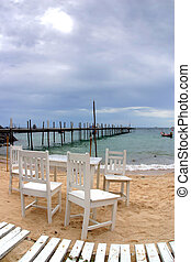 White Chairs on the Beach in Thailand.