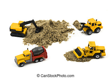 Trucks miniature working with sand isolated on white...