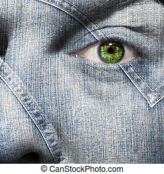 Denim fiber superimposed on a mans face with green eye
