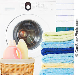 Pile of Towels with detergent and washing machine